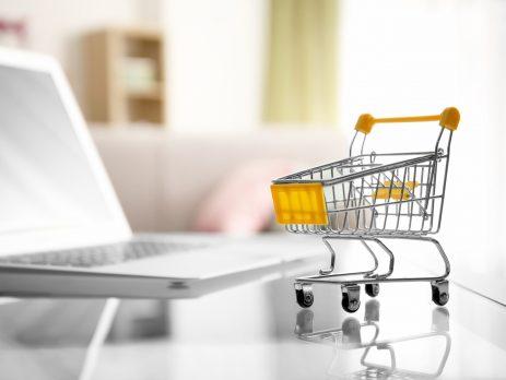 shopping cart next to computer